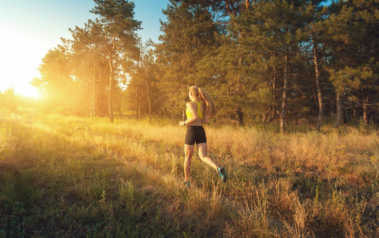 Girl jogging in a field